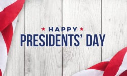Happy Presidents' Day Text with Flags Over White Wood